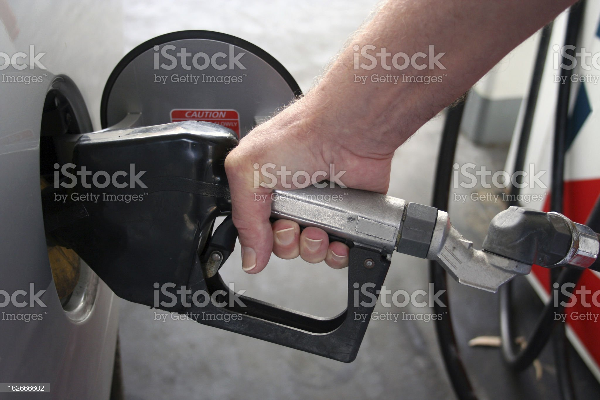 Gassing the car - horizontal royalty-free stock photo