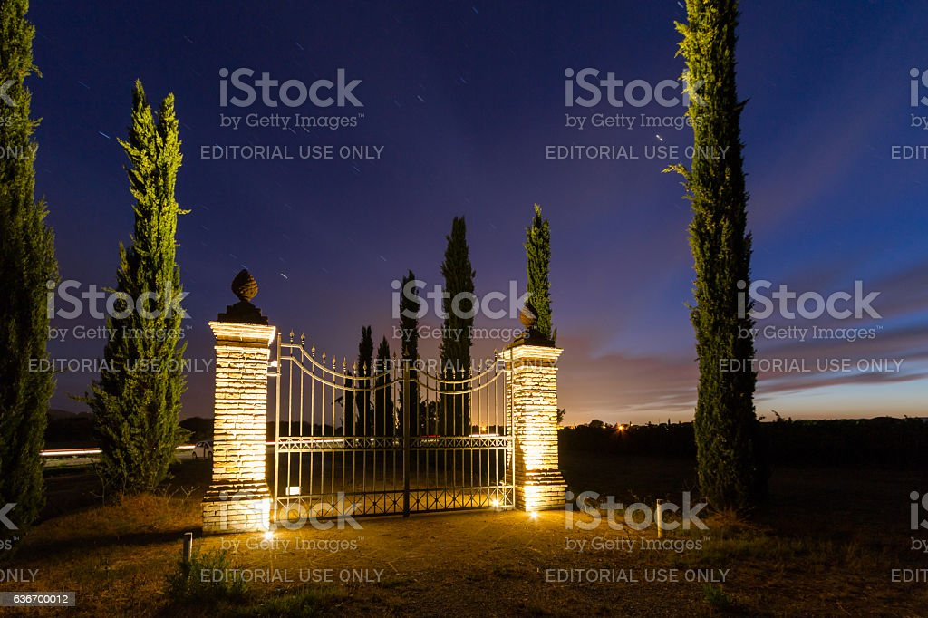 Gate at sunset in Tuscany stock photo