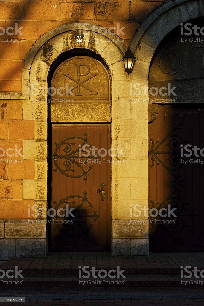 Gate church. Chi Rho cross stock photo
