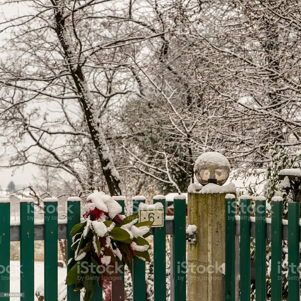 gate covered by snow on christmas time stock photo