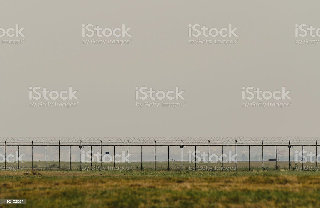 Gate in Fence With Cloudy Sky stock photo