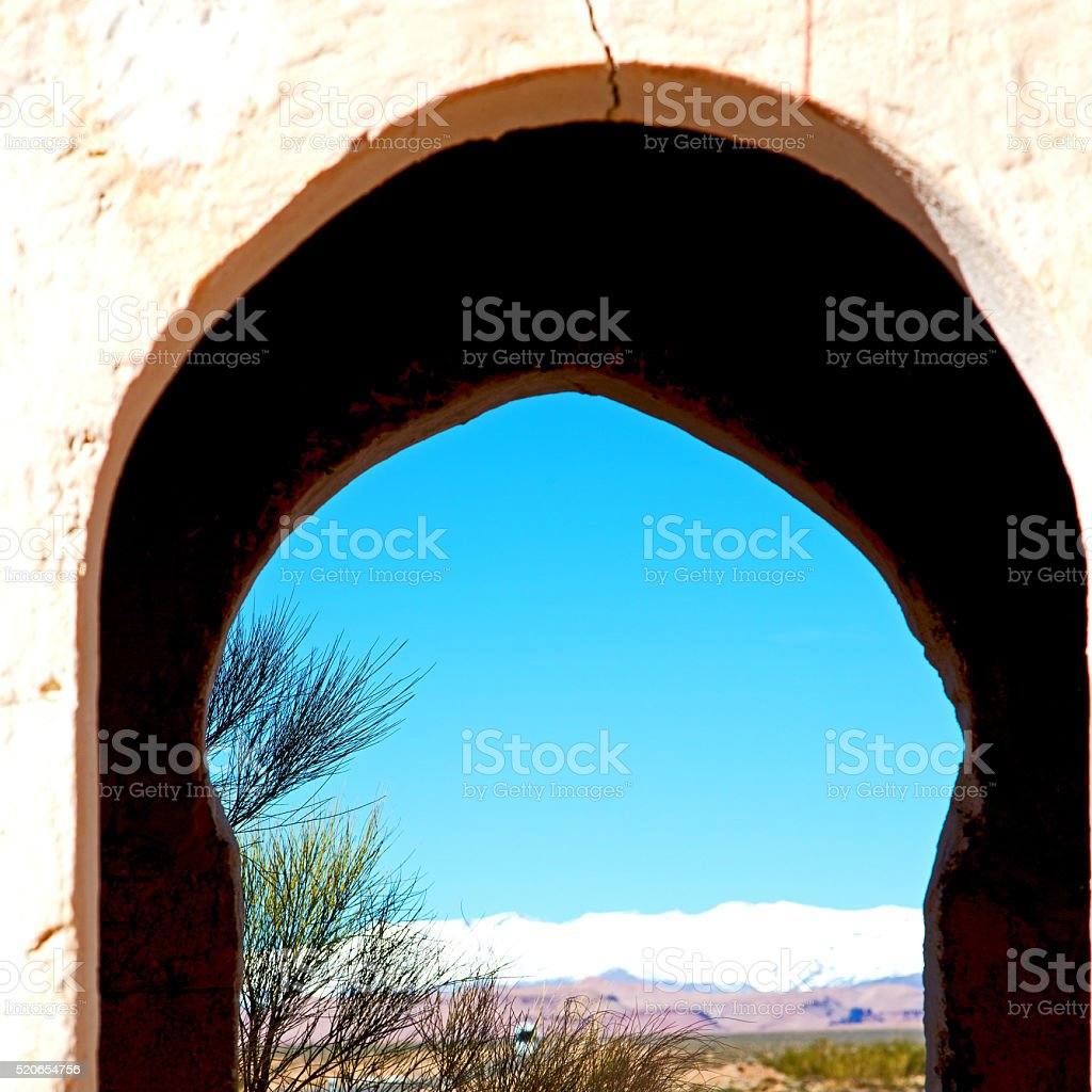 gate   in todra gorge morocco africa and  village stock photo