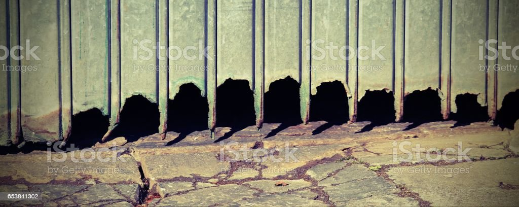 gate of the ruined garage against weather elements stock photo