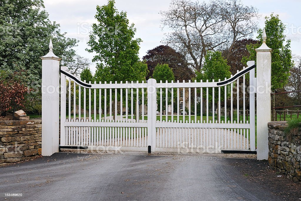 Gates and Driveway of a Country Mansion stock photo