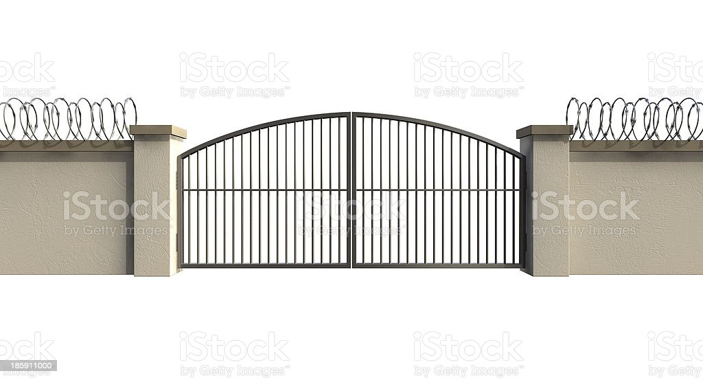 Gates And Wall With Razor Wire stock photo