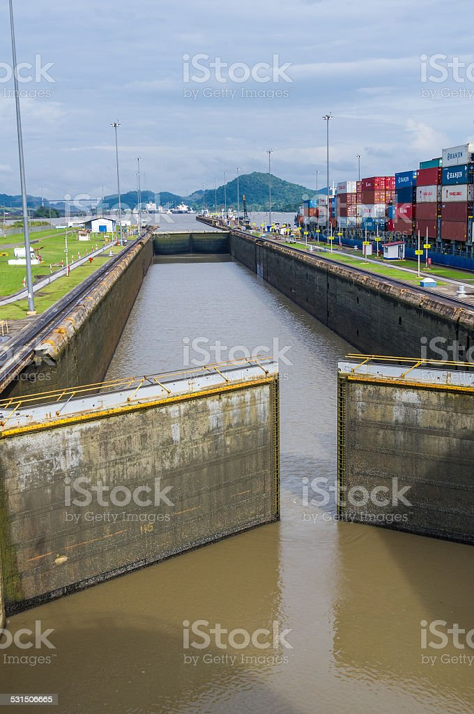 Gates of the Miraflores Locks partially open stock photo