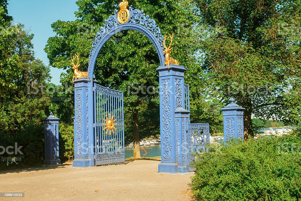 gates with golden deer stock photo