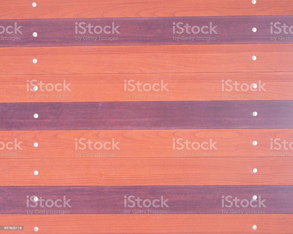 Gates Wood Alternately painted orange with purple Fasten stock photo
