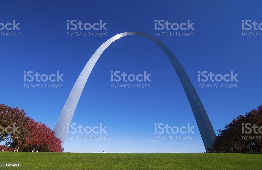 Gateway Arch front and red trees stock photo