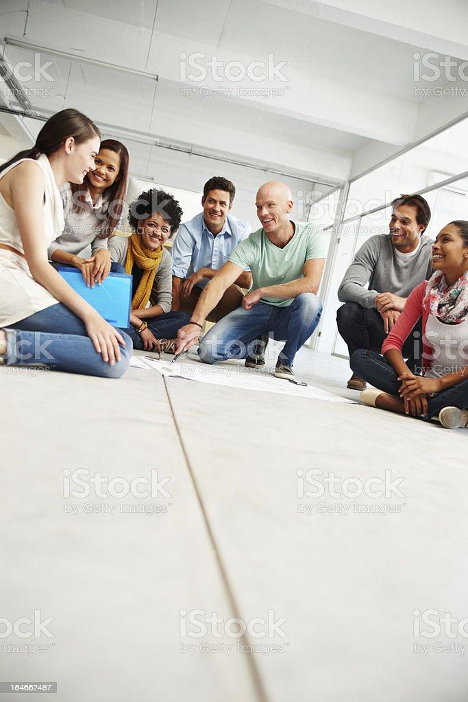 Gather round team royalty-free stock photo