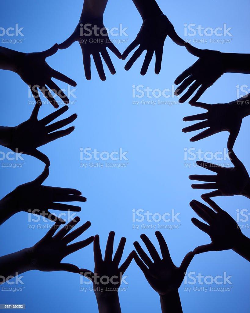 Gather your hands around stock photo