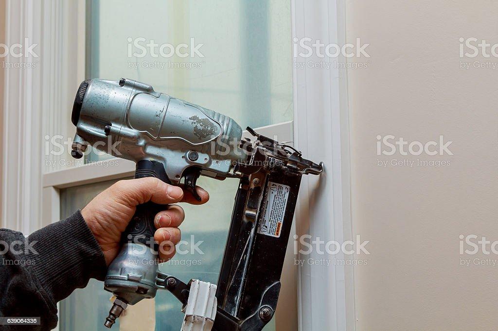Gauge Finish Nailer man nailed slats custom house building contractor stock photo