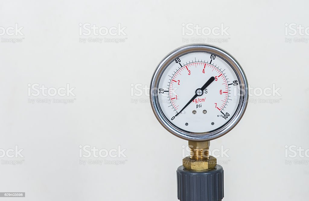 gauge pressure in the pipeline,a wall in the background. stock photo