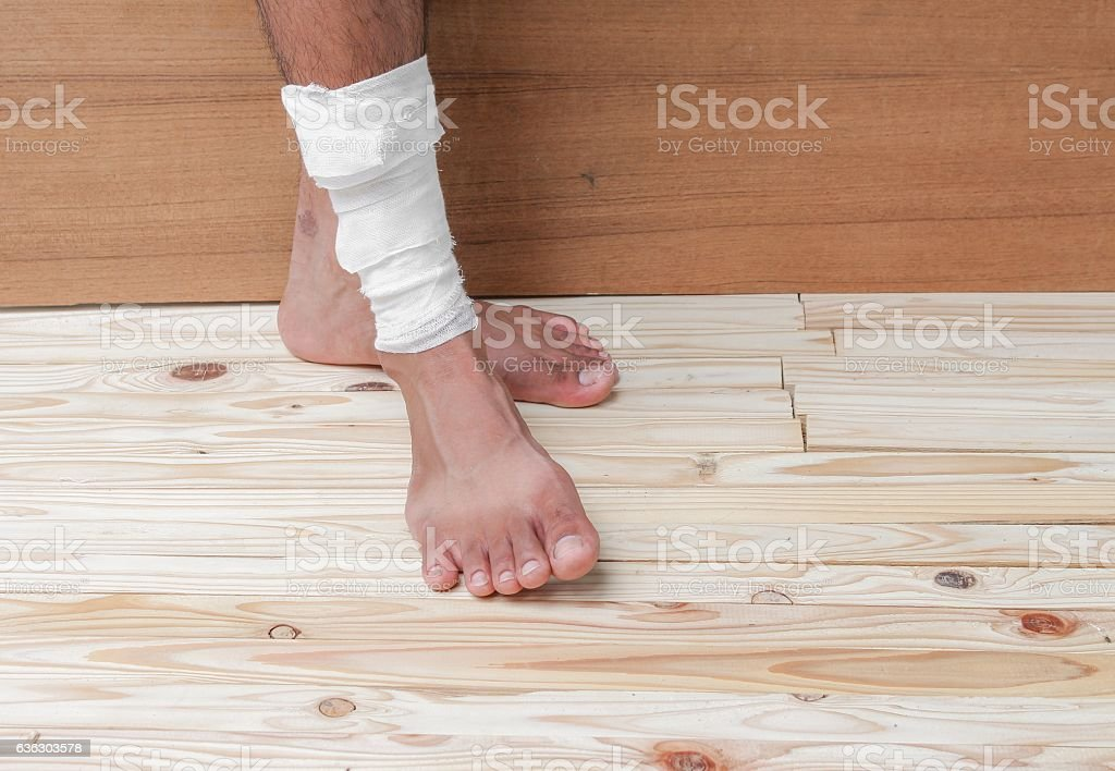 Gauze bandage of physician the treating case with ankle Injured on...