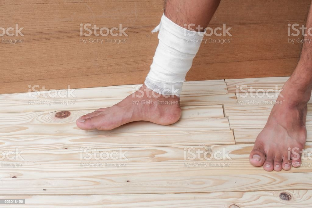 gauze bandage the foot treating patient ulcers male is wrap his...