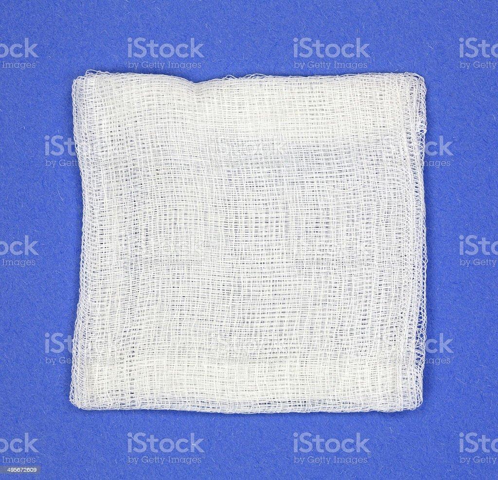 Gauze pad on blue background stock photo
