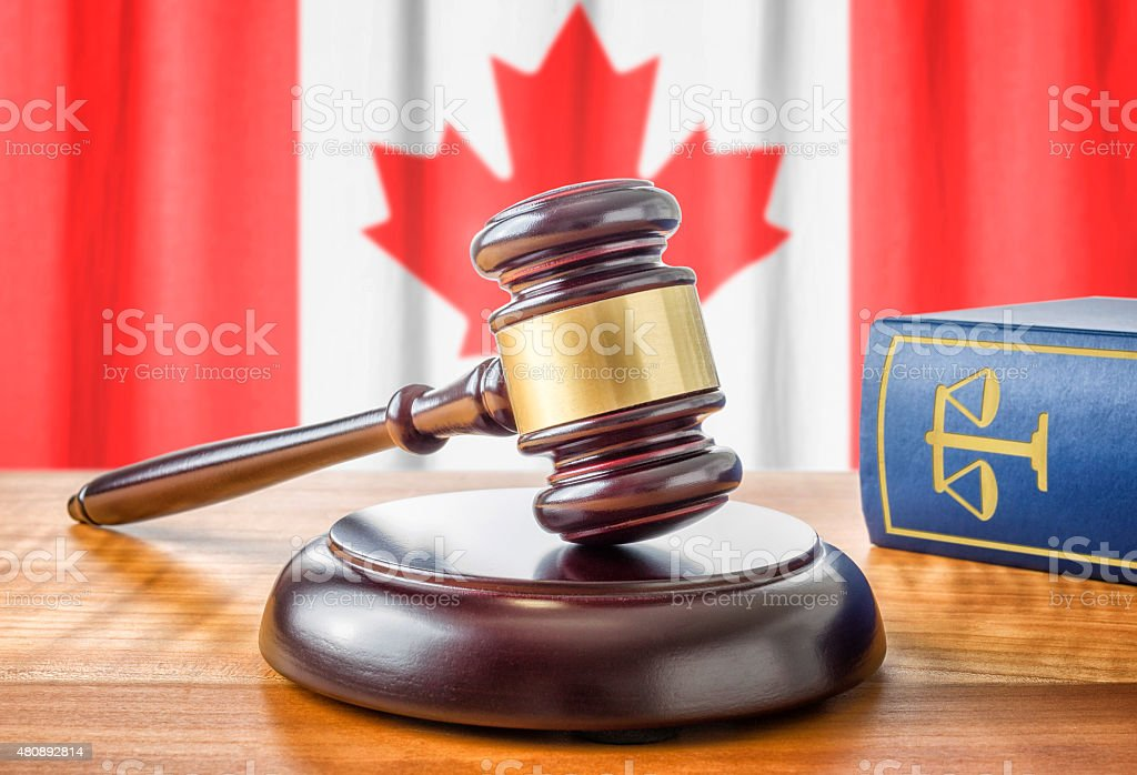 Gavel and a law book - Canada stock photo