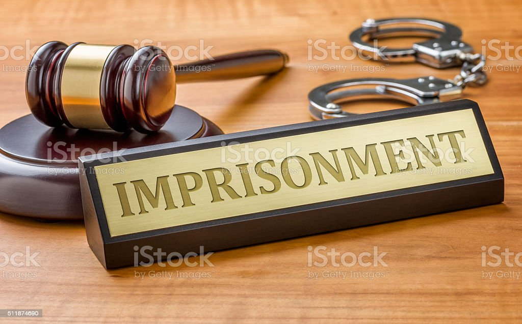 Gavel and a name plate with the engraving Imprisonment stock photo