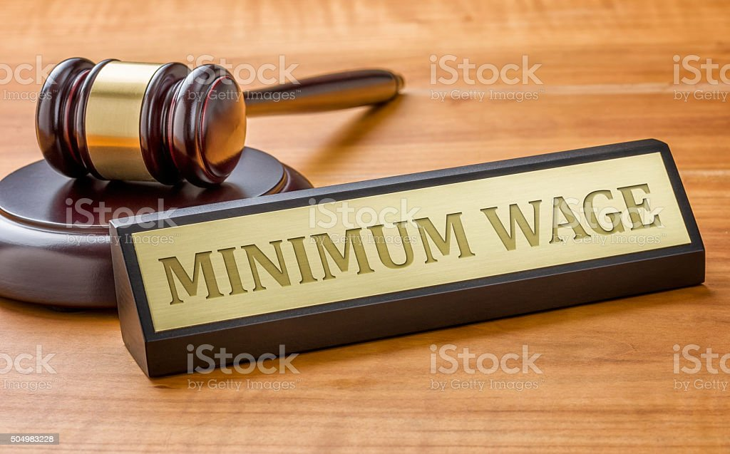 Gavel and a name plate with the engraving Minimum Wage stock photo