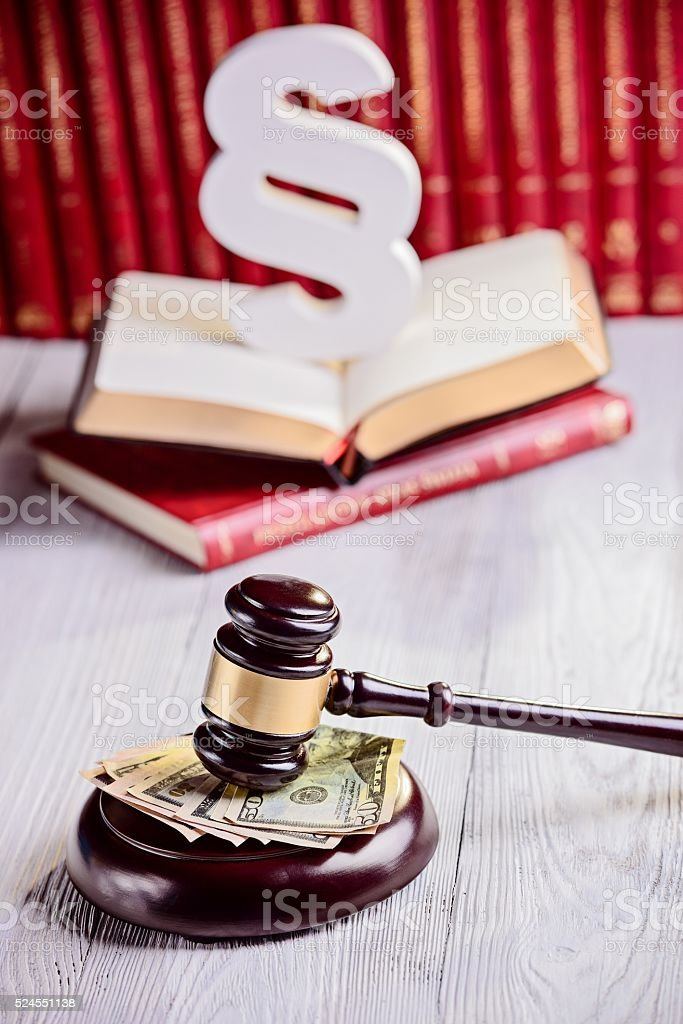 Gavel and american dollars in court library stock photo