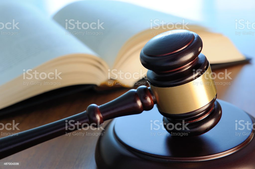 Gavel and book on a table stock photo