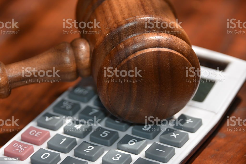 Gavel and calculator stock photo