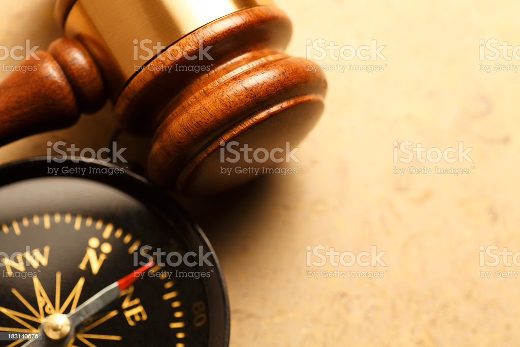 Gavel And Compass On Lightly Textured Surface stock photo
