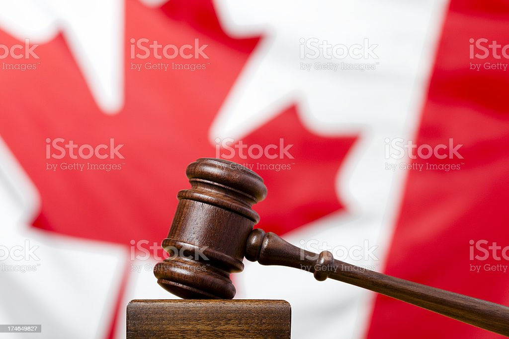Gavel and flag of Canada royalty-free stock photo