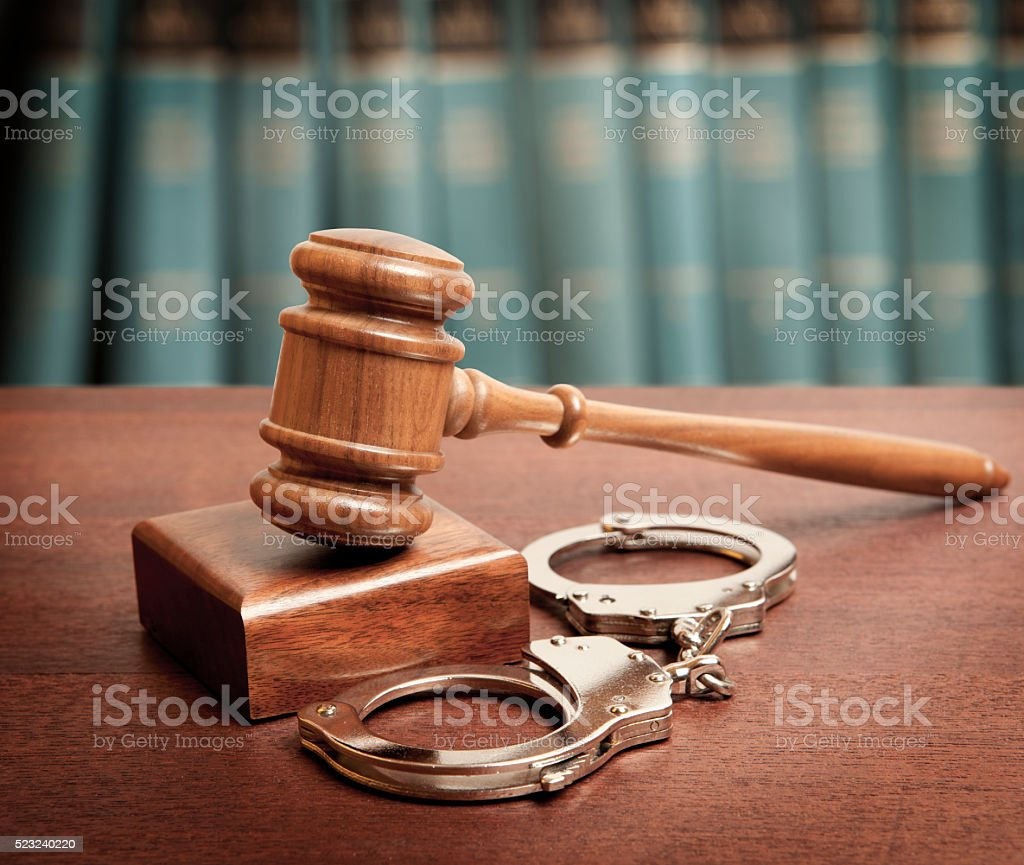 Gavel and handcuffs stock photo