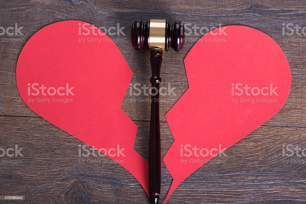 Gavel and heart in divorce concept stock photo