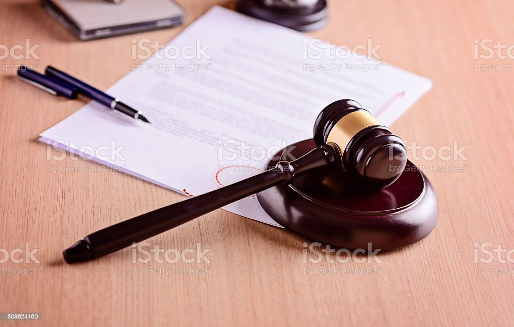 Gavel and judgement on desk. stock photo