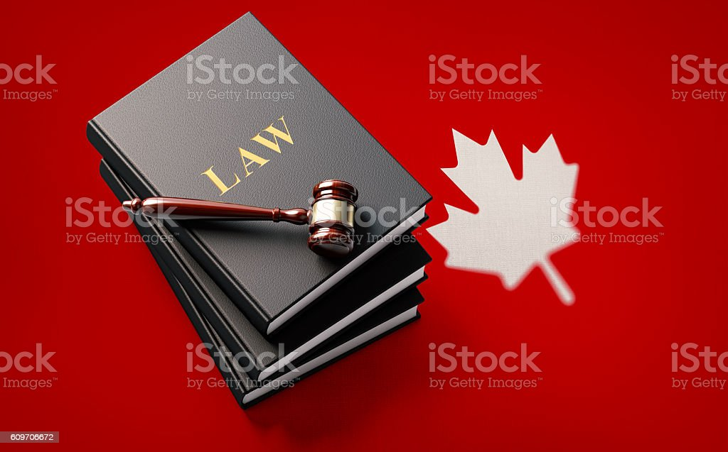 Gavel and Law Books on Canadian Flag: Canadian Justice Concept stock photo