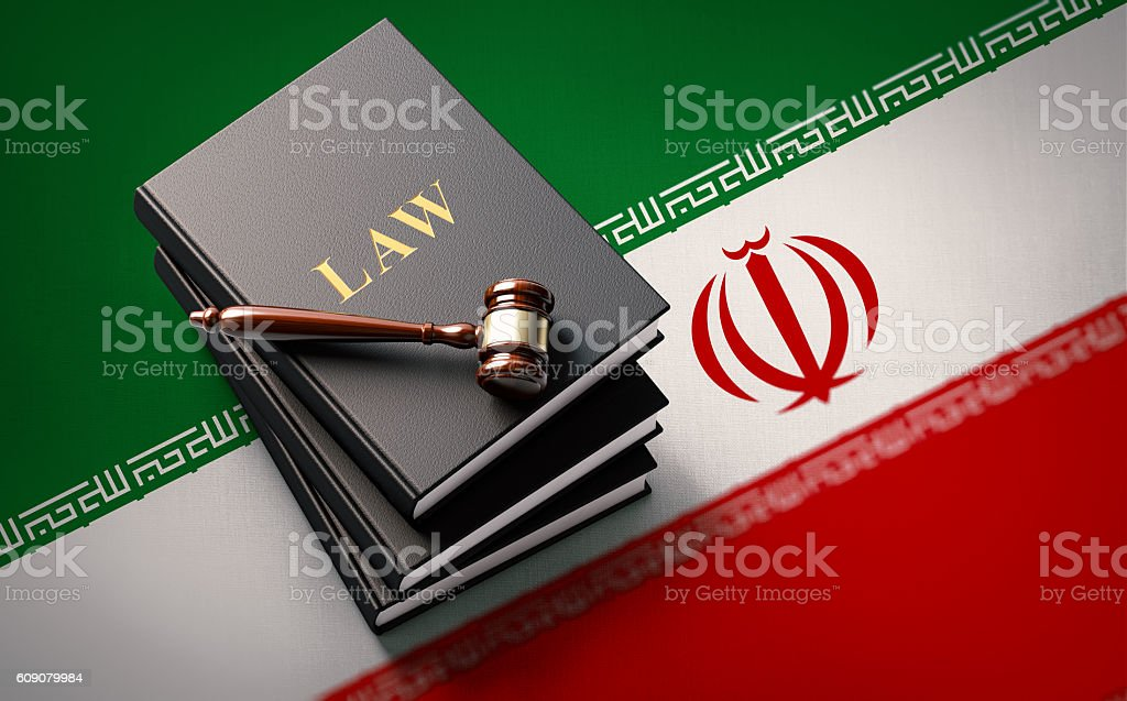 Gavel and Law Books on Iranian Flag: Iranian Justice Concept stock photo