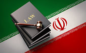 Gavel and Law Books on Iranian Flag: Iranian Justice Concept