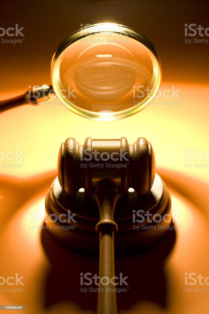 Gavel and Magnifying Glass stock photo