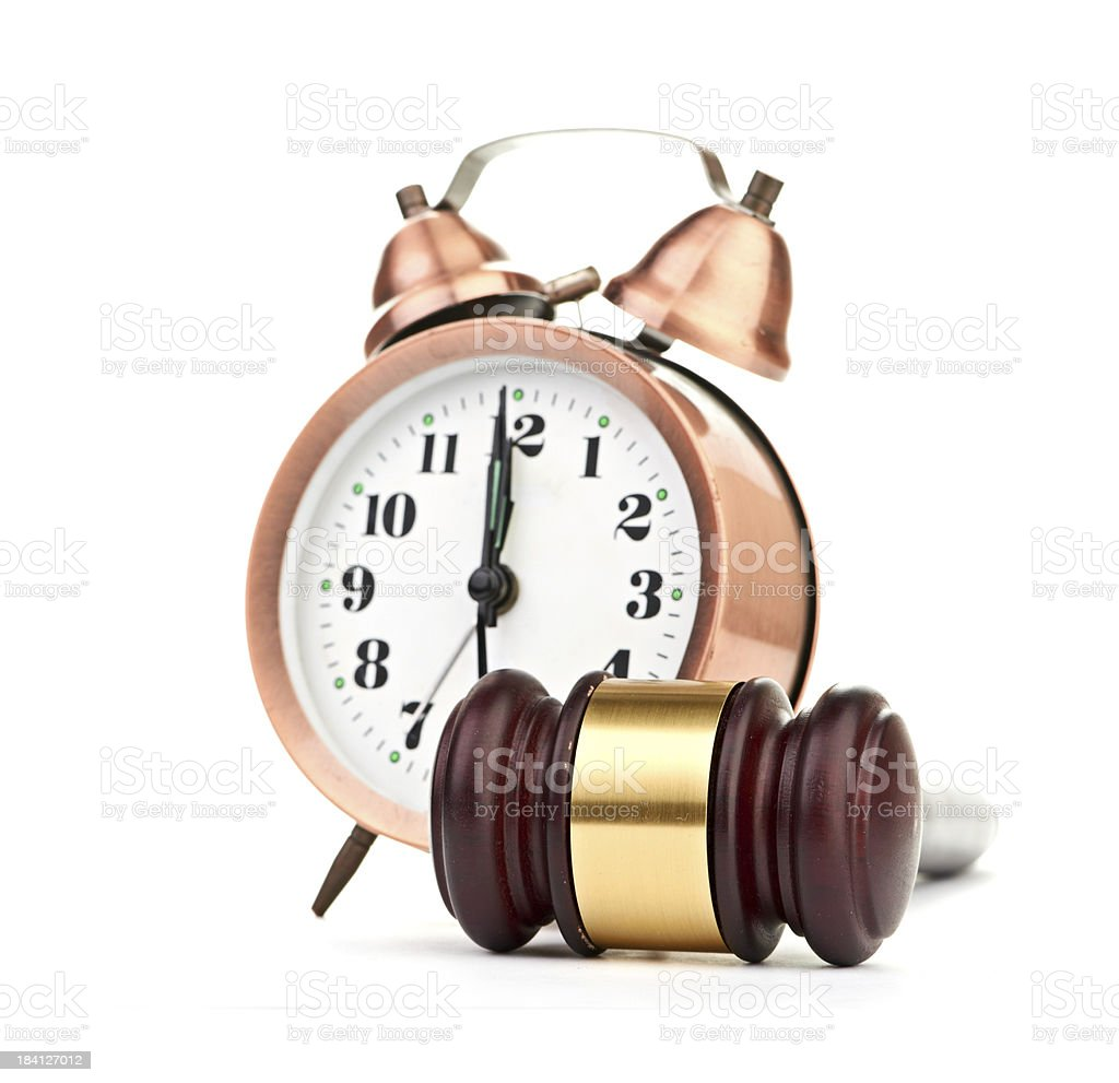 Gavel and old clock royalty-free stock photo