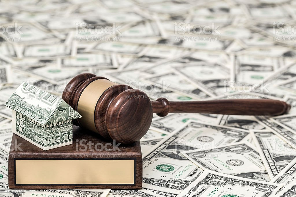 Gavel and origami house stock photo