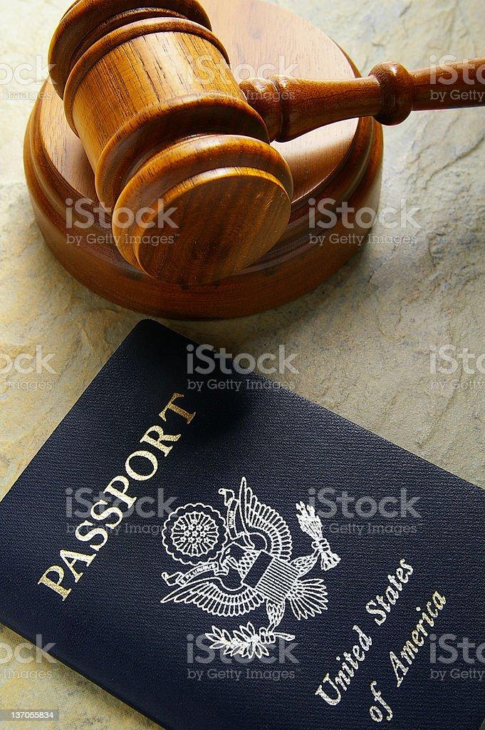 gavel and passport stock photo
