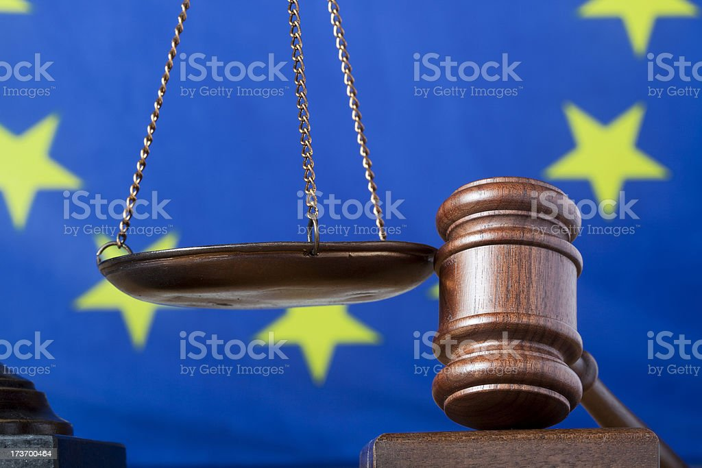Gavel and scale of justice against EU flag royalty-free stock photo