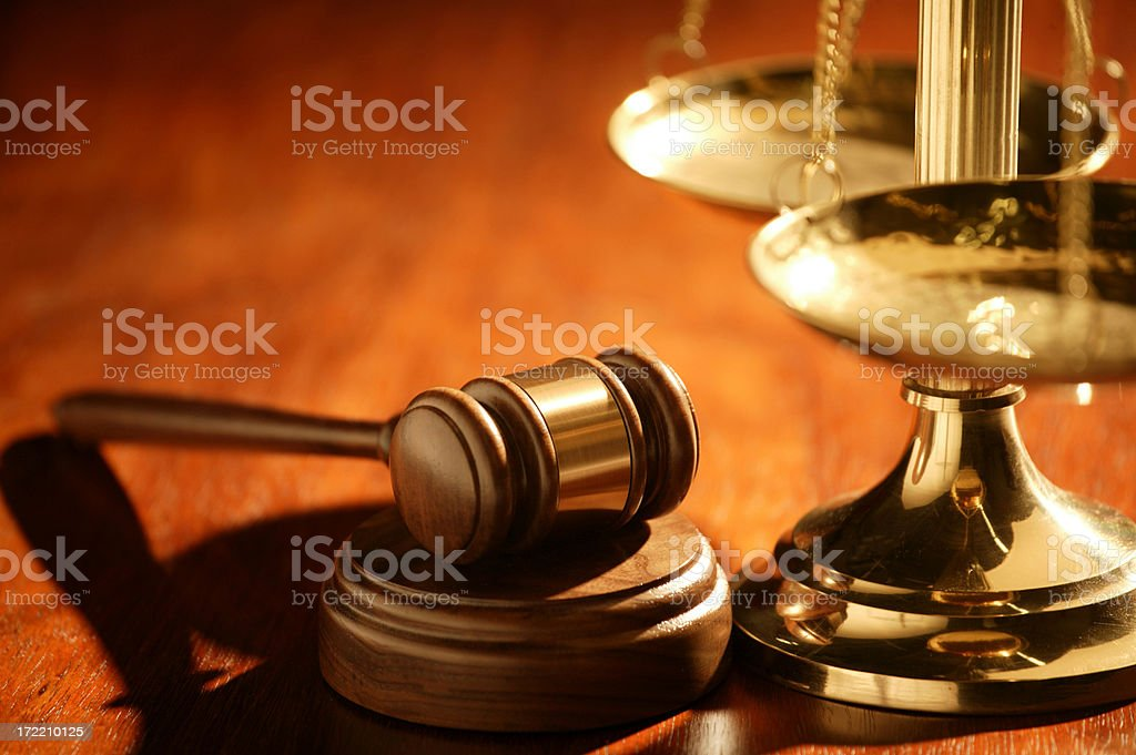 Gavel and scale of justice on wood table stock photo