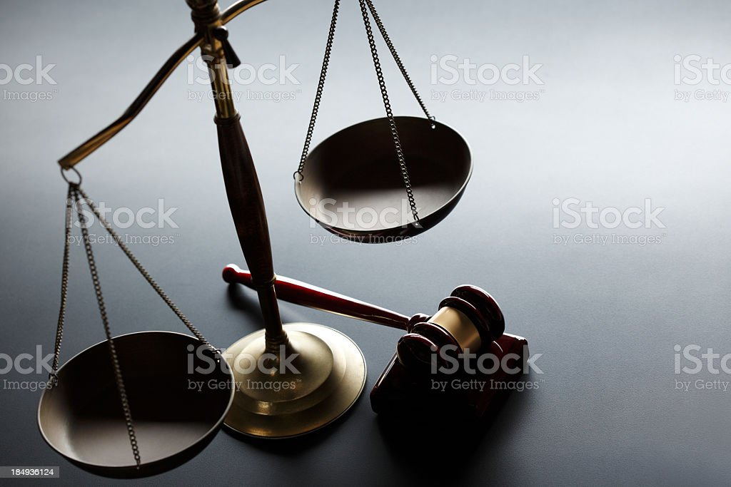 Gavel and scales of justice on gray background stock photo
