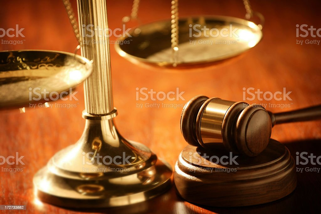 Gavel and scales of justice on wood table stock photo