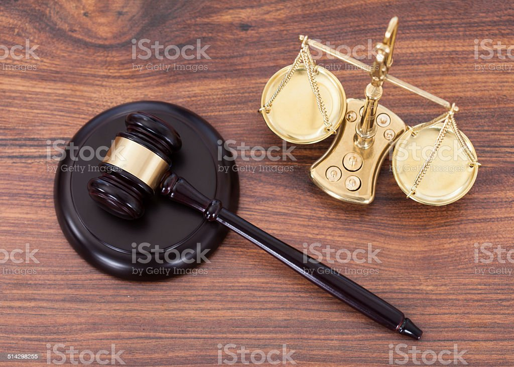 Gavel And Scales With Money On Desk stock photo