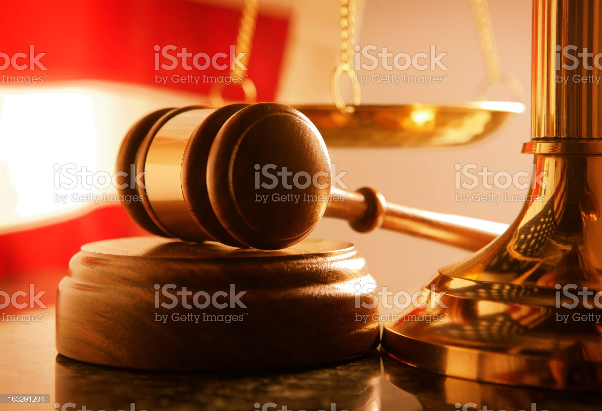 Gavel and sound block at base of brass scale of justice royalty-free stock photo
