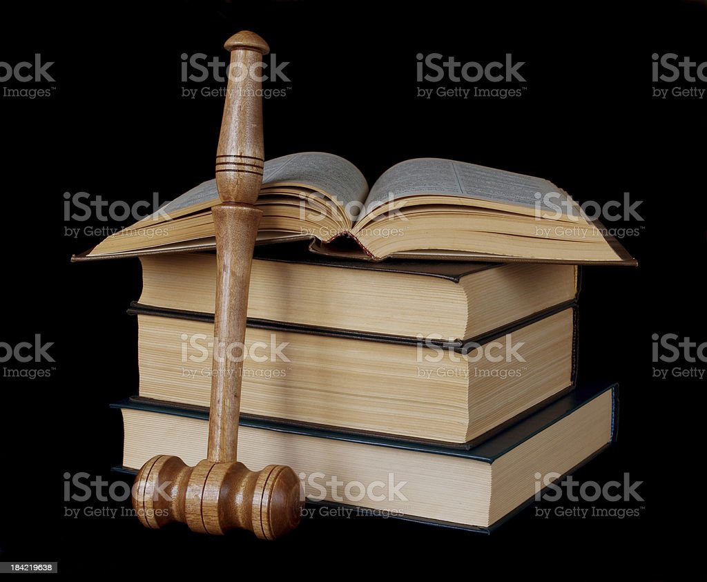 gavel and stack of thick old books royalty-free stock photo