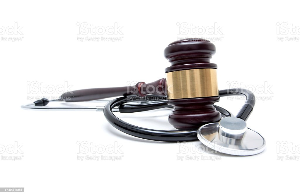 Gavel and stethoscope isolated on white background stock photo