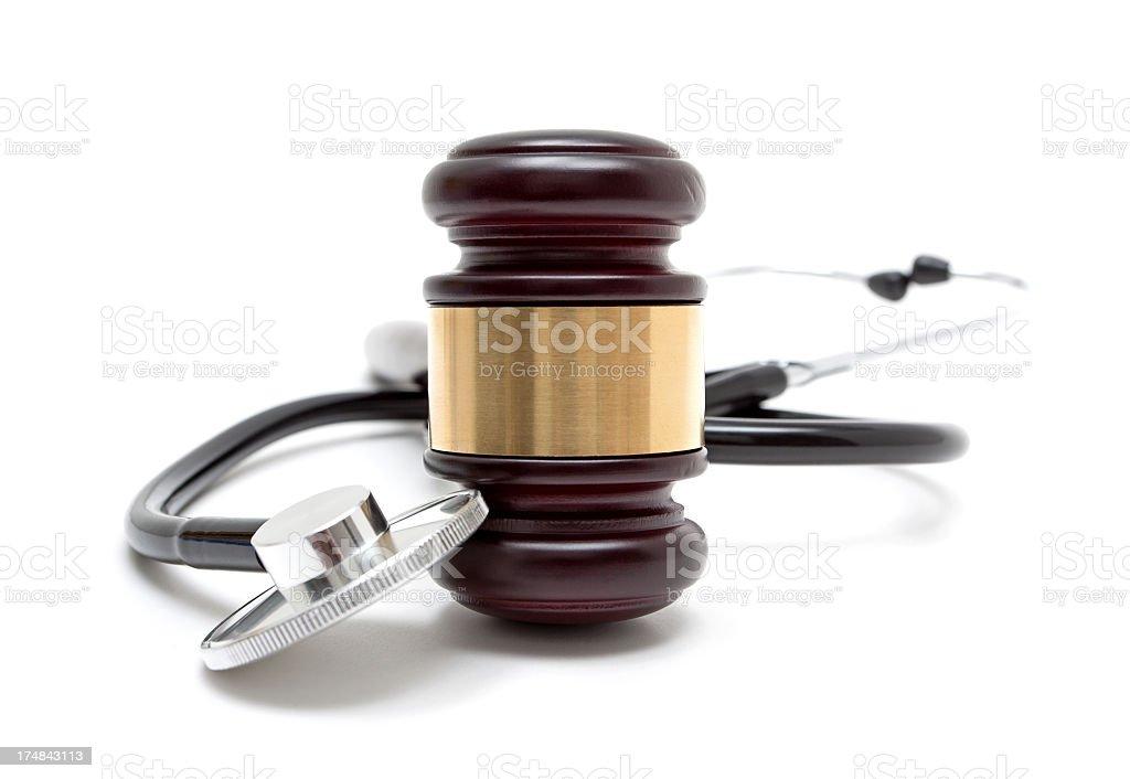 Gavel and stethoscope isolated on white background stock photo