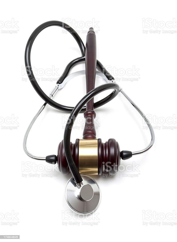 Gavel and stethoscope isolated on white background royalty-free stock photo