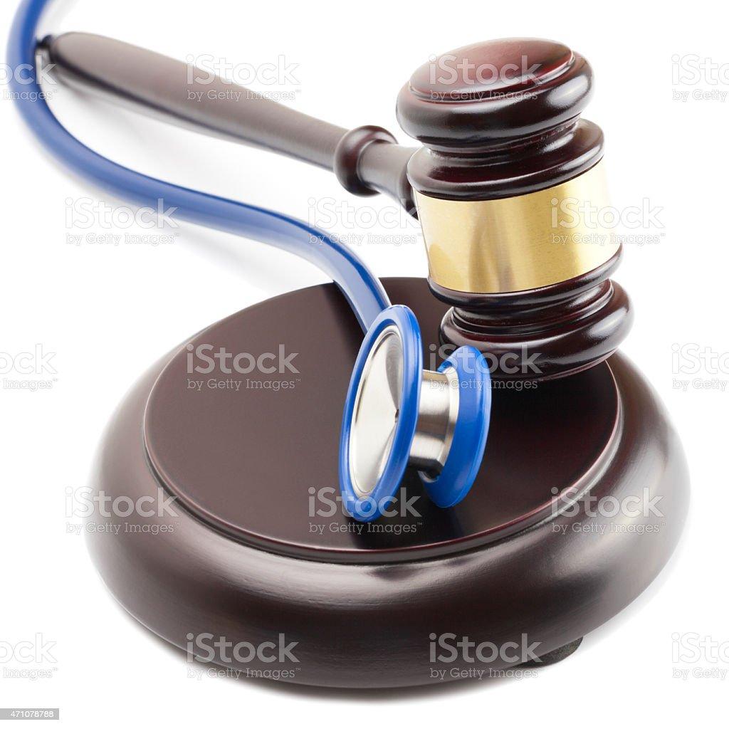 Gavel and stethoscope next to it - close up shot stock photo