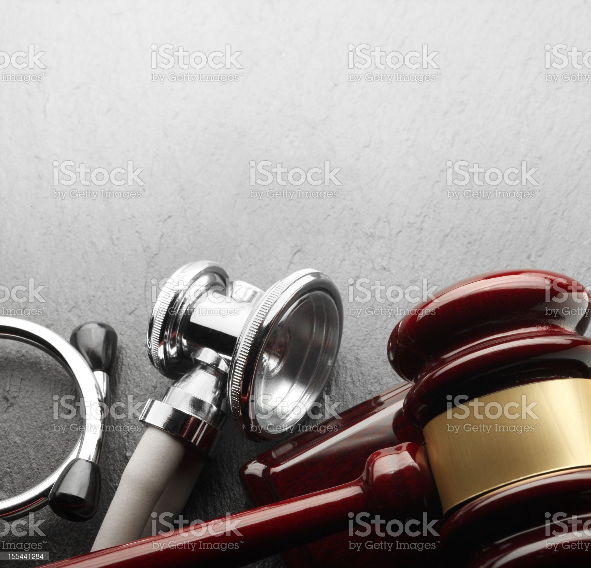 Gavel and stethoscope on black slate background royalty-free stock photo
